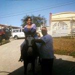 Having fin riding a horse .