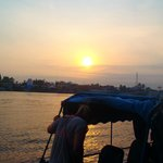 watching the sunrise while travelling on the Mekong into Cambodia