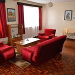 Lounge and coffee facilities outside room - with ironing board and iron