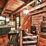 Frontier Log cabins,green log cabin kitchen area