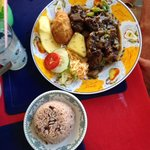 Curry Goat (w/rice & peas, yellow yam, festival, roasted breadfruit and side of salad)
