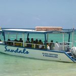 The boat that is used for the glass bottom boat tour and snorkeling.