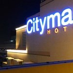 View to the Neon of Citymax by night from the roof Pool