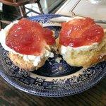 Warm scone, clotted cream and strawberry jam. Yum!