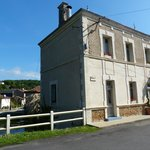 Exterior of the hotel which is at beginning of the Rue De la Gare, at one end of the village by
