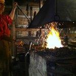 The Blacksmith stokes the flame