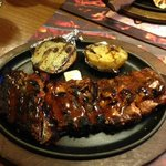 A view of the ribs with the baked potato