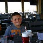 My son enjoying his ice cream on the deck.