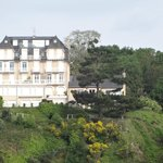 Villa Blanc Marine can be seen tucked behind the grand building in the foreground
