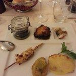 Spiedino di polpo con granella di nocciole, raviolo di patata con salmone, parmigiana di tonno,