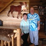 Cathy and CD in front of a copper moose