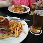 Firkin Burger, near side ... Butter Chicken Pie, far side