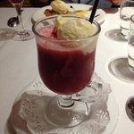 Yogurt ice cream in berry purée
