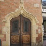 Decorative door & coat of arms belonging to an important trader of Pastel