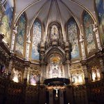 Inside of the church at Montserrat, the black Madonna is up behind the altar and crucifix