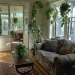 a sitting area extending into the sunroom