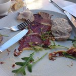 Aged beef carpaccio with olive oil and pine nuts. Very nice.