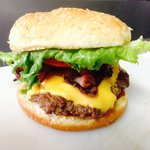 Regular burger with cheese and bacon. The cowboy burger is bigger!