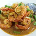 Prawns in red curry sauce.