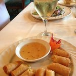 A lovely starter of spring rolls and Sauvignon Blanc; notice the carved radish