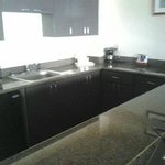 The kitchen is large, but the cabinets are empty and it contains no appliances to cook with.