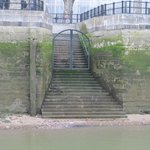 A landing and stairway onto the Thames