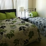 two beds with mismatched covers - not a queem as ex[ected