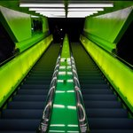 Neon green escalators