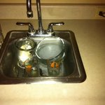 Dirty dishes left to soak by owner; No clean coffee cups for next morning.