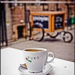 Fairtrade Puro Coffee sitting outside The Project Cafe, Glasgow