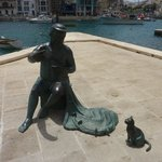 Fisherman and cat statue