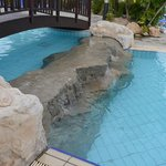 Bridge and rock area between two pool areas