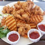 Fried shrimp with waffle fries.