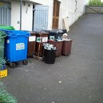 Rubbish bins right next to lower ground floor rooms