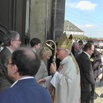 Bishop Heiner Koch greets the congregation at the end of the Mass