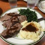 Leg of lamb, mashed potatoes and spinach