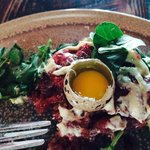 New York strip steak tartare with Quail egg and arugula.