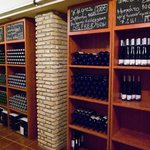 Wine from the family's winery sold to-go from Oinopoleion's underground cellar