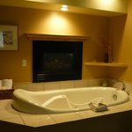 Hot tub with fireplace in our room--the Meadowlark