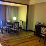The nice and spacious hotel room's living room area
