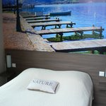 Queensize bed with photo wall paper