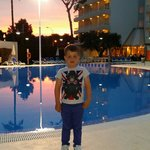 My son next to the pool at sunset :) I want to go back now :(