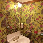 The funky bathroom wallpaper room 17
