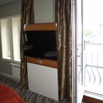 Room 522 giant TV and terrace doors