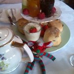 'Wee Guy' mascot enjoying his cream tea!