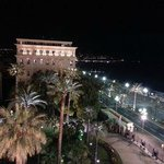 View from room at night, along Promenade des Anglais toward centre of Nice