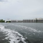 View of resort from speed boat in lagoon