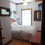 2nd bedroom with queen size bed and shower