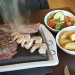 Duo of rump with surf and turf sizzling away