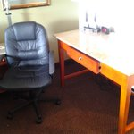 granite desk and leather office chair in room was nice